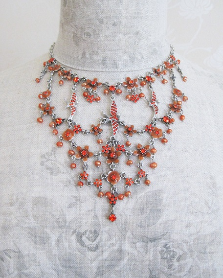Elaborate Swallow & Flower Pilgrim Necklace Fire Orange/Oxidised Silver